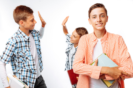 Teen guys give five to each other, teamwork, desire to win