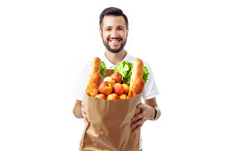 Young handsome hipster man holding a bag of food isolated on white background, advertising, text insertion Archivio Fotografico - 108584980