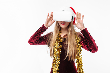 Portrait of a young girl in a Santa Claus hat with glasses, 3D glasses. on a white background.