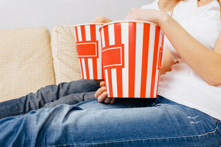 hands hold popcorn, homely atmosphere