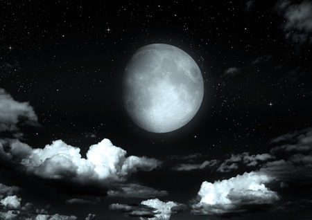 The moon in the night sky in clouds \\\