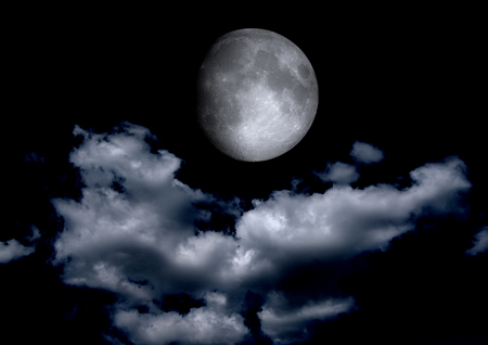 half globe: The moon in the night sky in clouds Stock Photo