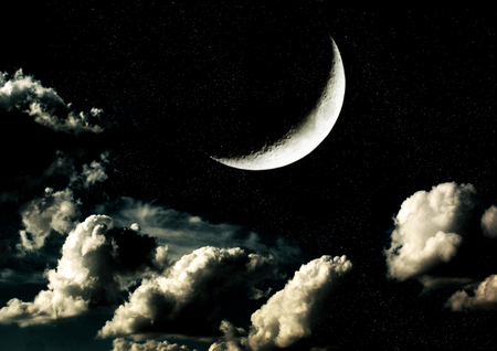 The moon in the night sky in clouds Stock Photo