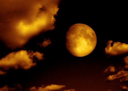 The moon in the night sky in clouds Elements of this image furnished by NASA Stock Photo