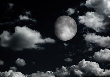 The moon in the night sky in clouds 3D illustration Stock Photo