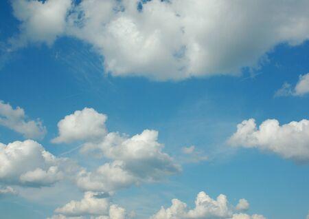 white clouds in a blue sky Фото со стока