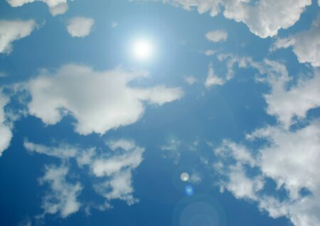 white clouds in a blue sky Imagens