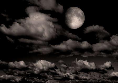 The moon in the night sky Фото со стока