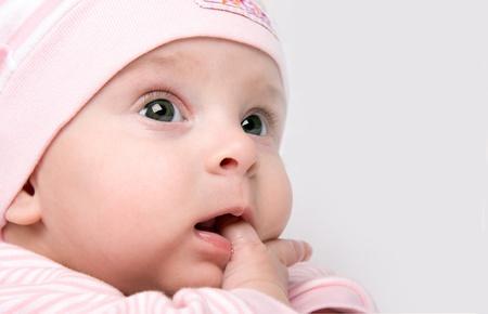 unconcerned: Baby girl looks unconcerned as long as her finger