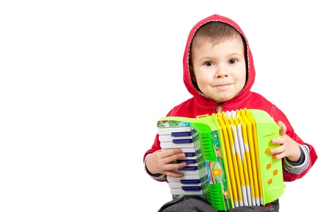 Isolated young boy playing a diatonic accordion photo