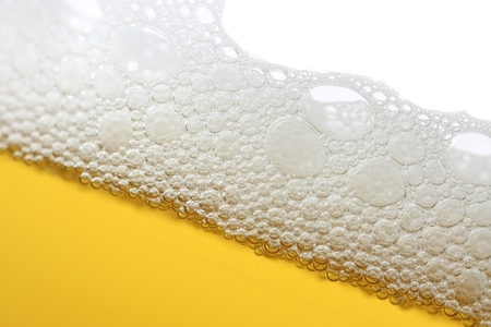responsibly: A close-up image of a beer with a foam head.