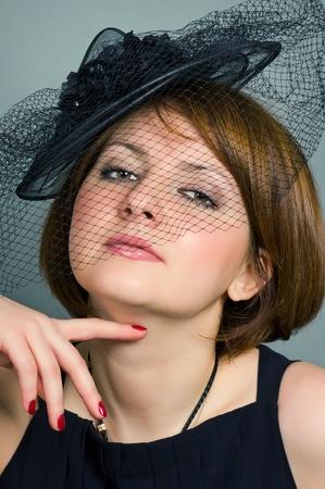 arrogancia: mujer con un sombrero