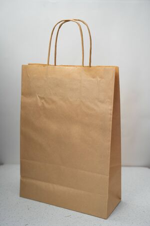 paper bag on a light background with handles