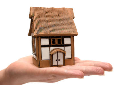 playhouse: House in hand on a white background Stock Photo