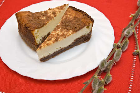 Two pieces of cheesecake on the plate with catkins Stock Photo