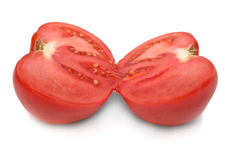 Two slices of ripe tomato on white background
