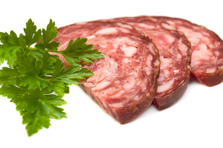 Smoked sausage with parsley on white background Stock Photo