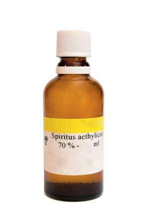 Medicine bottle with 70% Spiritus aethylicus on white background