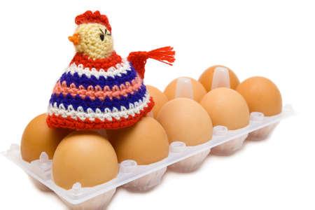 Easter still-life. Homemade cock and eggs on white background Standard-Bild