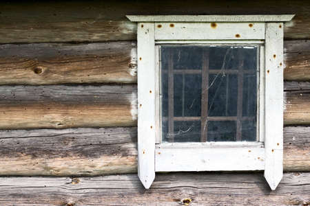 Old white window in a old wooden wall Stock Photo