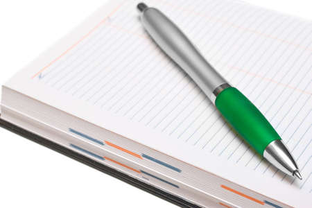 Pencil and Pocket Planner on white background photo