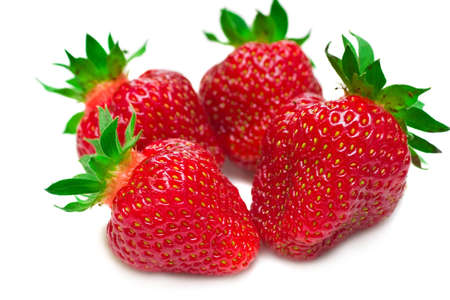 Four fresh red strawberries, isolated on white with soft shadow