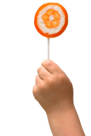 lollipop in the hand of a child on white background Stock Photo