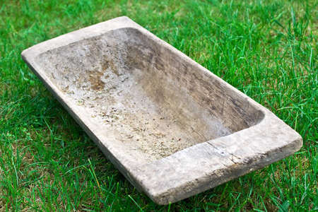 Vintage household equipment. The old wooden trough