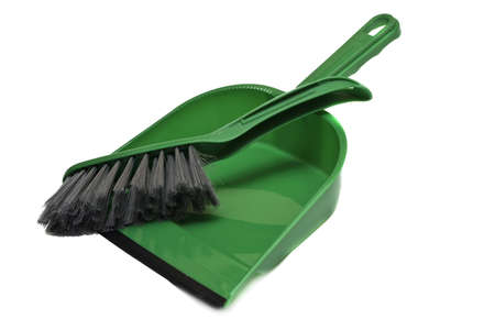 A green brush and dustpan isolated on white background Stock Photo - 12172779