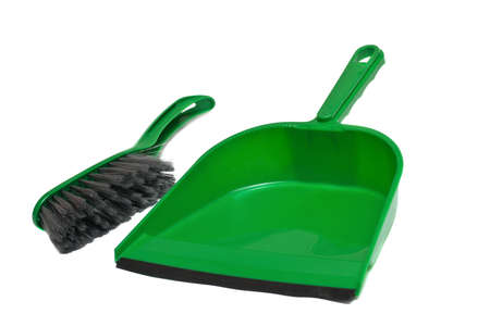 A green brush and dustpan isolated on white background