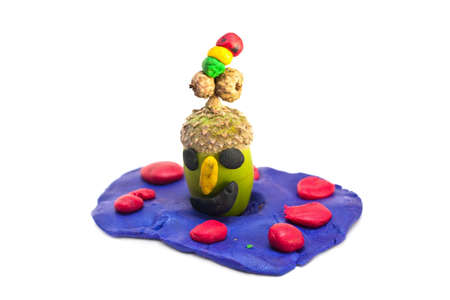Plasticine funny man made by child on white background