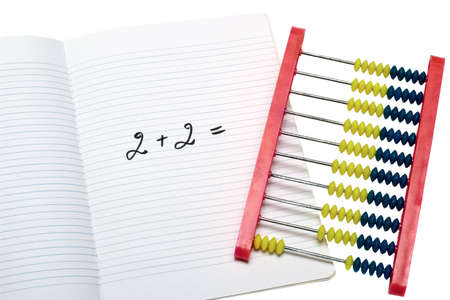 The concept about a education problem. Exercise book and abacus on white background Stock Photo