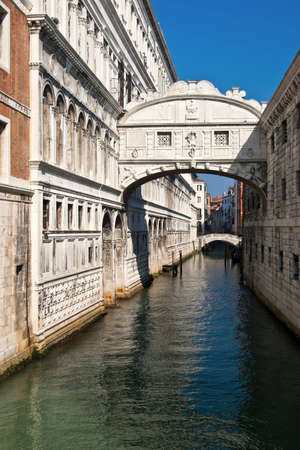 Canal, buildings and bridge in Venice, Italy.