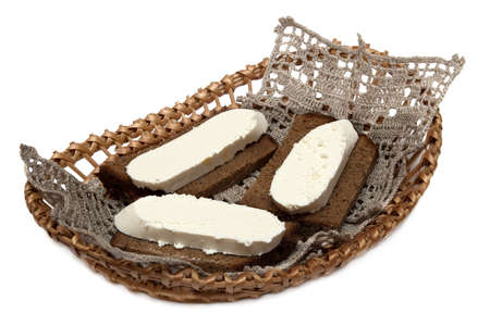 Sandwiches with wholemeal bread and white cheese on white background