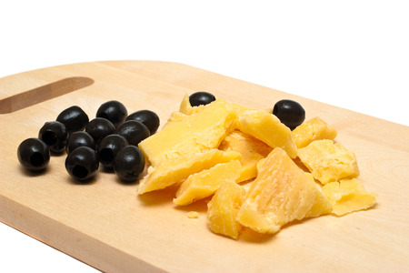 Traditional Lithuanian cheese and olives on white background