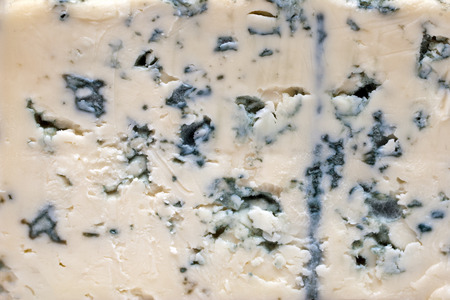 Close up of blue cheese. Cheese background