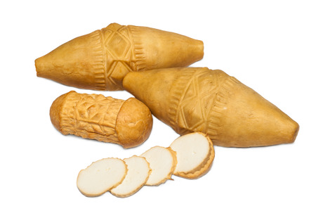 oscypek: Traditional Polish smoked cheese - oscypek on white background