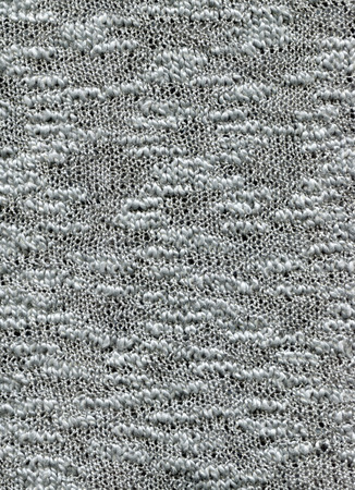 Associated webs of boucle yarn for the background. Fleecy fabric texture.