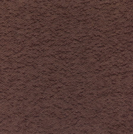 Brown wool fabric with a boucle texture. Decorative material for the background.