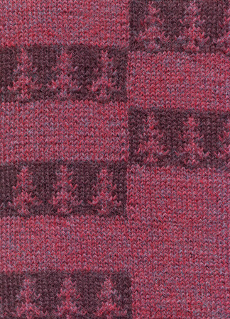 Knitted fabric with a pattern of horizontal stripes in a herringbone pattern.Decorative material, background, texture, wallpaper