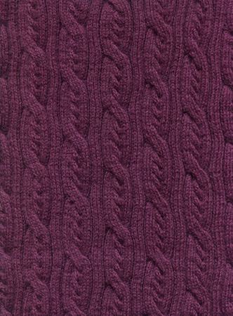 Knitted fabric with a pattern of vertical braids.Decorative material, background, texture, wallpaper Banque d'images