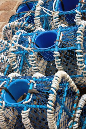 bind: bow-nets piled up on a wharf