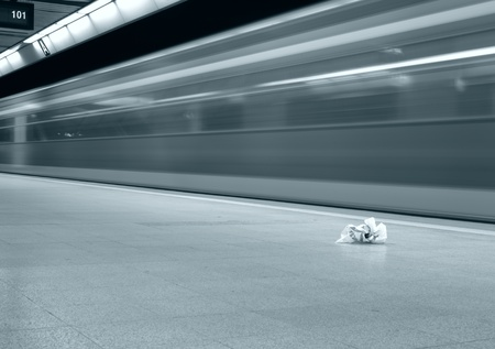 superficial: motion blurred speed train in subway