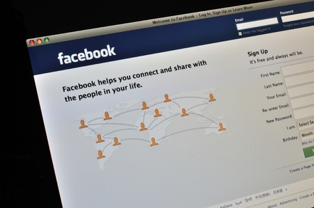 Facebook homepage displayed in a Safari browser on a computer monitor. Stock Photo - 10434813