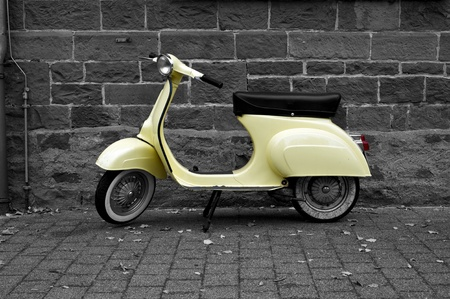 scooter: Old yellow italien vespa scooter