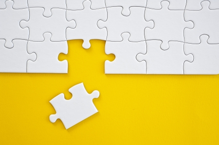 absence: Business Teamwork Concept by Jigsaw Puzzle Pieces