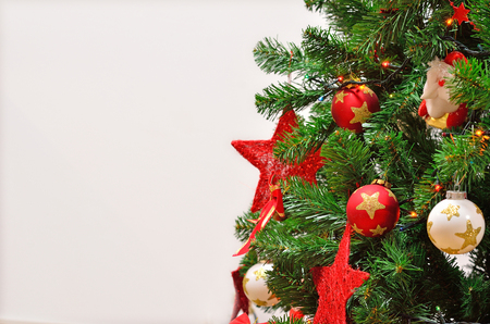 christmas (new year tree) eve and toy of Santa Claus with garlands and lights and other decorations