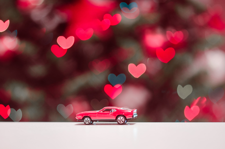 model of red car on the background of heart Stock Photo
