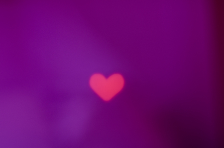 pink heart on the purple background Stock Photo