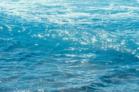 blue water of ocean with splash